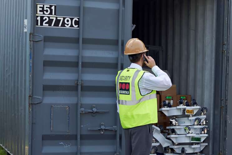 Securitas On-site Guarding Officer inspects a container at a client site.