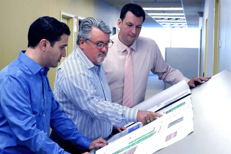 Electronic Security colleagues reviewing a security system design