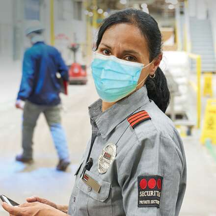Female security officer wearing a mask.