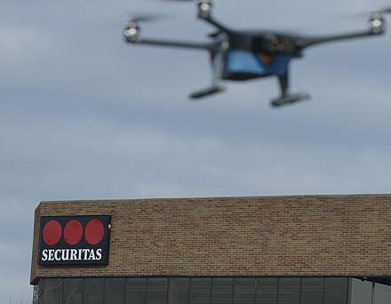 Securitas logo with a drone