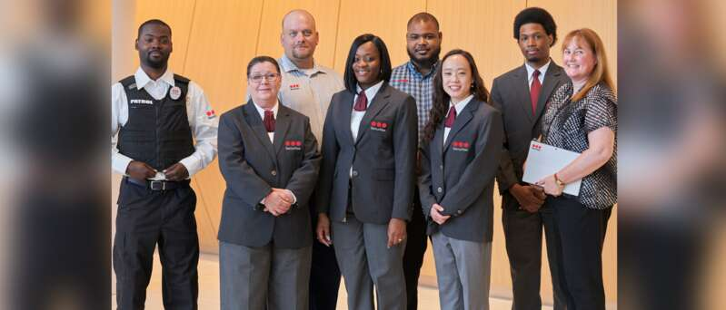 Securitas management and security officers in a group photo.