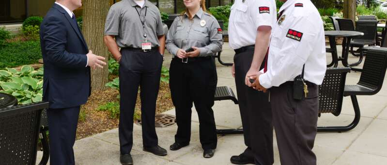 A group of security officers with a client.