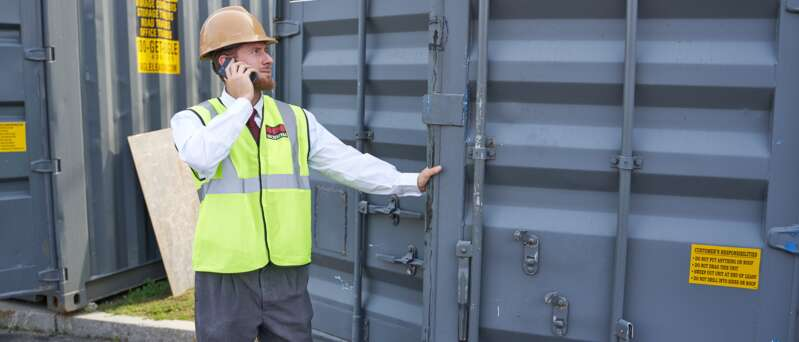 Male security officer checking an open container.
